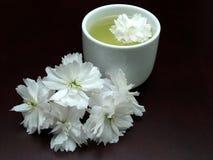 An Asian floral cup of tea stock photos