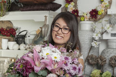 Asian in a flower shop Stock Images