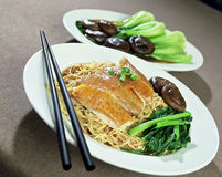 Asian Food. Asian dish of Chicken, Noodles, Mushrooms and green vegetable Royalty Free Stock Images