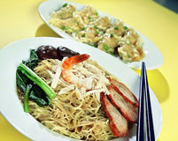 Asian Food. Asian dish of Prawns, Chicken, Beef, Noodles, Mushrooms and green vegetable stock photo