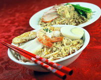 Asian Food. Asian dish of Prawns, Seafood, Tofu, Noodles, and green vegetable Stock Image