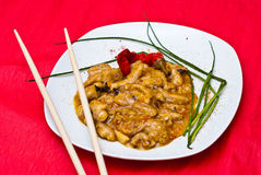 Asian food. Dish of Asian food made from chicken with sweet and sour sauce Royalty Free Stock Image