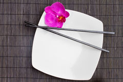 Asian food. Concept - epmty plate and chopsticks Stock Photo
