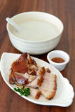 Asian food. Homemade roasted pork and duck served with porridge Stock Photography