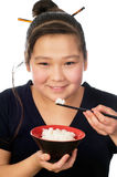 Asian food. Asian girl eats rice, isolated on a white background stock photo