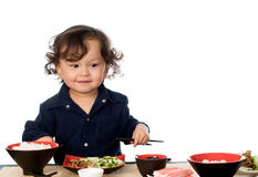 Asian food. Little boy eats asian food, isolated on a white background stock images