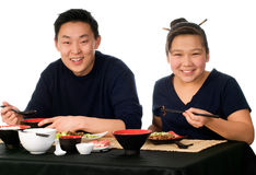 Asian food. Father and daughter eat the asian food stock photos