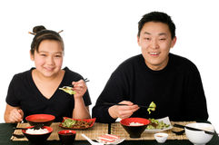 Asian food. Father and daughter eat the asian food royalty free stock images