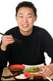 Asian food. Young men eats asian food, isolated on a white background royalty free stock photos