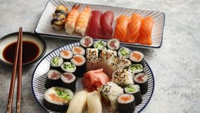 Asian food assortment. Various sushi rolls placed on ceramic plates