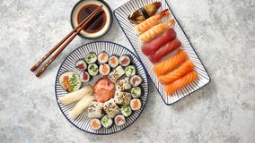 Asian food assortment. Various sushi rolls placed on ceramic plates stock video