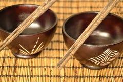 Asian food bowl. An asian bowl and shopsticks ona a pad Stock Photography