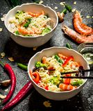 Asian food. Chinese noodles with vegetables and shrimp. On an old rustic background Stock Photography