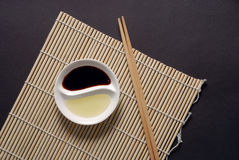 Asian food concept with copy space in landscape. Asian dipping sauces in Yin Yang shape with chopsticks Stock Images