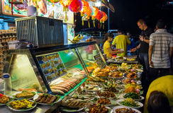 Asian food-court on the street. A quantity of different asian dishes on the food-court Royalty Free Stock Photography