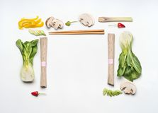 Asian food creative layout frame on white desk background, top view. Asian cuisine ingredients. With soba noodles , vegetables, spices and pak choi. Vegetarian Stock Photos