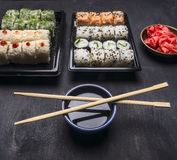 Asian food delivery home, sushi sets in plastic containers soy sauce and chopsticks Royalty Free Stock Photography