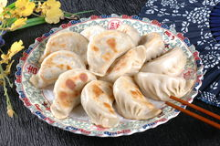 Asian food dumplings. A plate of dumplings,black background Royalty Free Stock Photos