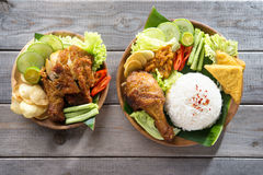 Asian food. Famous traditional Indonesian food. Delicious nasi ayam penyet with sambal belacan. Fried chicken rice royalty free stock photos