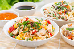 Asian food - fried rice with tofu, noodles with vegetables royalty free stock photography