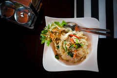 Asian food. Fried Thai Rice noodles with meat and vegetables. Stock Images