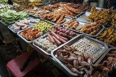 Asian food in Hanoi in Vietnam. Street market with Vietnamese cousine. Raw chicken, heart and feet in trays. raw material for. Asian food in Hanoi in Vietnam stock photography