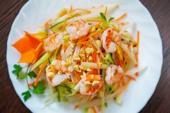 Asian Food In Vietnamese Restaurant.Delicious Seafood From Vietnam.Boiled Shrimps Served With Fresh Green Vegetables On White Royalty Free Stock Photo