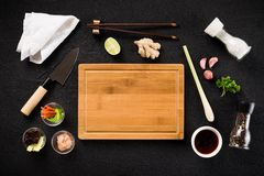 Asian food ingredients and cutting board Royalty Free Stock Photography