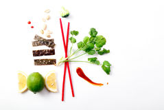 Asian food ingredients. And red sticks on white background with copy space Royalty Free Stock Images