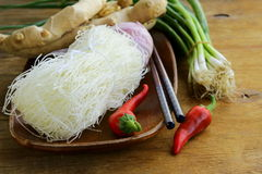 Asian food ingredients - rice noodles, ginger, chili pepper Royalty Free Stock Photo