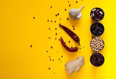 Asian food ingredients and spices on a bright yellow background. The concept of the most popular dishes in the world, copy space. Asian food ingredients and royalty free stock photo