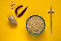 Asian food ingredients, spices and sauces on a bright yellow background. The concept popular Chinese dishes copy space. Asian food ingredients, spices and sauces royalty free stock photography