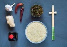 Asian food ingredients, spices and sauces on a dark background. The concept of the most popular Chinese dishes in the world. Some types of Asian cuisine, top royalty free stock images