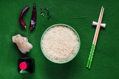 Asian food ingredients, spices and sauces on a dark  background. The concept of the most popular Chinese, top view, copy space. Asian food ingredients, spices Stock Photos