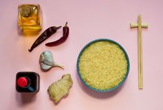 Asian food ingredients, spices and sauces on a lilac background. The concept of the most popular Chinese dishes, copy space. Asian food ingredients, spices and stock image
