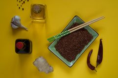 Asian food ingredients, spices and sauces on a yellow background. The concept of the most popular Chinese dishes in the world. Some types of Asian cuisine, top stock photo