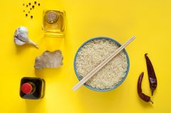 Asian food ingredients, spices and sauces on a yellow background. The concept of the most popular Chinese dishes in the world. Some types of Asian cuisine, top stock images