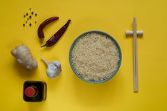 Asian food ingredients, spices and sauces on a yellow background. The concept of the most popular Chinese dishes in the world. Some types of Asian cuisine, top stock photography