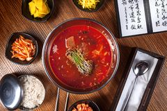 Asian food. korean cuisine. Top view spicy korean yukkedyan soup with kimchi and rise. Traditional korean cuisine set. Picture for royalty free stock photos