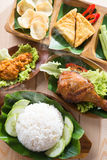 Asian food nasi ayam penyet. Famous traditional Indonesian food. Delicious nasi ayam penyet with sambal belacan. Fried chicken rice stock image