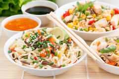 Asian food - noodles with vegetables and greens, fried rice Stock Photo