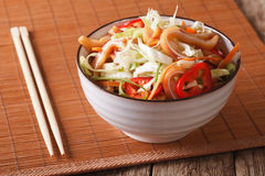 Asian food: Pig ears salad with fresh vegetables on the table. h Royalty Free Stock Images