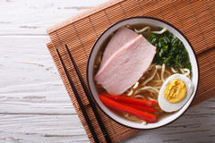 Asian Food: Ramen noodles with pork and egg. horizontal top view Royalty Free Stock Photos