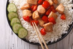 Asian food: rice with chicken close-up. horizontal top view Stock Photography