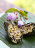 Asian food, Rice dumpling. Steamed rice dumpling wrapped with lotus leaf. Focus on the first one, shallow depth of field Royalty Free Stock Photo