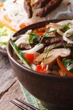 Asian food: rice noodles with shiitake, meat and vegetables Stock Photos