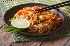 Asian food: rice noodles with shrimp and vegetables Stock Images