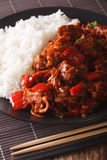 Asian Food: Rice with pork stew with vegetables closeup. vertica Royalty Free Stock Photography