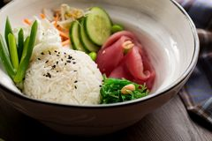 Asian food: rice with sesame and tuna in a restaurant royalty free stock photography