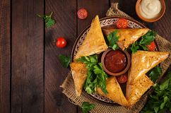 Asian food. Samsa samosas with chicken fillet and cheese. On wooden background. Top view royalty free stock photos